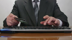 Businessman using credit card for online transaction Stock Footage