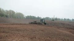 Crawler tractor harrow agricultural field Stock Footage