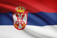 Serbian flag blowing in the wind. part of a series. Stock Illustration