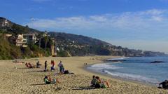 Sunbathers On Southern California Beach Winter Day- Laguna Beach CA Stock Footage
