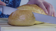 Stock Video Footage of Closeup hands cutting bread