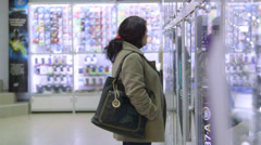 DOLLY: Customers in electronics store Stock Footage