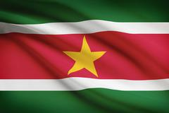 surinamese flag blowing in the wind. part of a series. - stock illustration