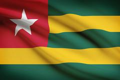 togolese flag blowing in the wind. part of a series. - stock illustration