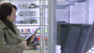 Stock Video Footage of DOLLY: Customer looking for digital tablet in electronics store