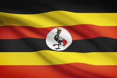 ugandan flag blowing in the wind. part of a series. - stock illustration