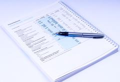 Stock Photo of financial statements with pen