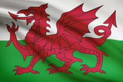 welsh flag blowing in the wind. part of a series. - stock illustration