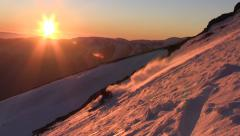 Skier on backcountry mountain at sunset - stock footage