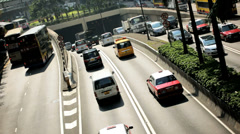 Traffic intersection city underpass, Hong Kong, China - stock footage