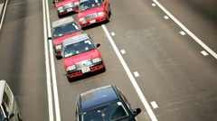 Red white taxis Hong Kong Island Central district, China - stock footage