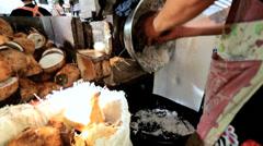 Shredding coconut, Phuket Market, Thailand Stock Footage