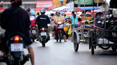 Motorized bikes at outdoor market, Phuket, Thailand Stock Footage