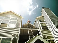 Inspiring constructor on the top of the roof - stock photo