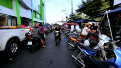 Motorized bikes at outdoor market, Phuket, Thailand - stock footage