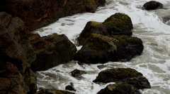Slow motion water against rocks Stock Footage