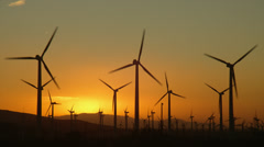 WIND TURBINES AT SUNRISE – PALM SPRINGS, CALIFORNIA (ZOOM OUT) Stock Footage