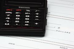 calculator and checks - stock photo