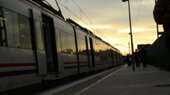 People arriving on train during sunset Stock Footage