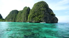 Limestone karsts emerald green water, Phi Phi National Park, Thailand - stock footage