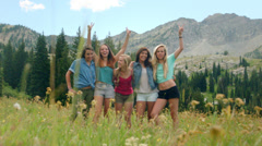 Five Teenage Girls Raise Their Hands In The Air And Celebrate Stock Footage