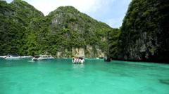 Limestone cliffs emerald green water, Phi Phi Island, Thailand - stock footage