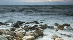 Storm waves crash against the rocks Stock Footage