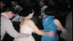 Conga line breaks out at New Years Eve party, 776  vintage film home movie Stock Footage