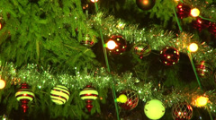 Christmas tree decorations, colored light bulbs, real fir tree Stock Footage