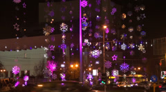 Colored Christmas lights in the city, street decorations, traffic, rush hour Stock Footage