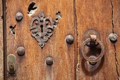 Old wooden door with lock and handle Stock Photos