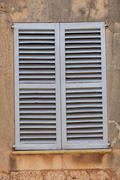 Window with closed wooden shutters Stock Photos