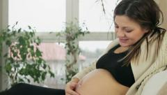 Pregnant woman touches her belly, tracking shot HD Stock Footage