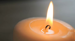 Candle with a yellow flame Stock Footage