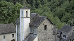 Small forgotten traditional village and church, lost on the Italian Swiss Alps. Stock Footage