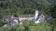 Stock Video Footage of Small forgotten traditional village and church, lost on the Italian Swiss Alps.