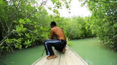 Thai boatman navigating Mangrove forest, Thailand, Stock Footage