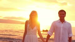 happy romantic bride and groom, sunset wedding on tropical beach, hd video - stock footage