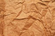 Stock Photo of crumpled brown paper background
