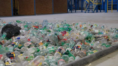 Waste processing - plastic bottles at recycling center. Stock Footage