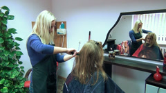 Barber woman communicate customer and make care her new haircut Stock Footage