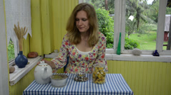 Sad woamn room rural prepare healthy dried calendula tea Stock Footage