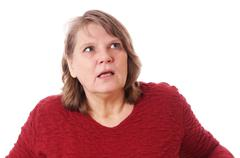shocked woman looking up - stock photo