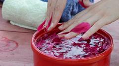 Woman remove wet adhering peony petals wet finger Stock Footage