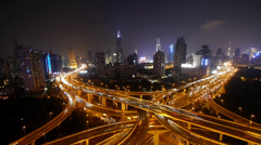 Timelapse of driving & cars racing by with streaking lights trail at night. Stock Footage