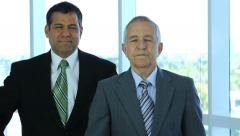 Senior and mid adult businessmen Stock Footage