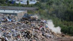 Bulldozer in the city dump Stock Footage