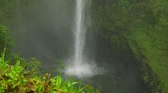 HAWAII – AKAKA FALLS DURING RAIN – WATER HITS POOL Stock Footage