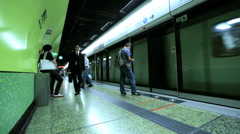 Metro train stopping at station  Hong Kong, China Stock Footage