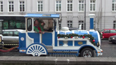 Christmas train with elf ride with children in city street Stock Footage
